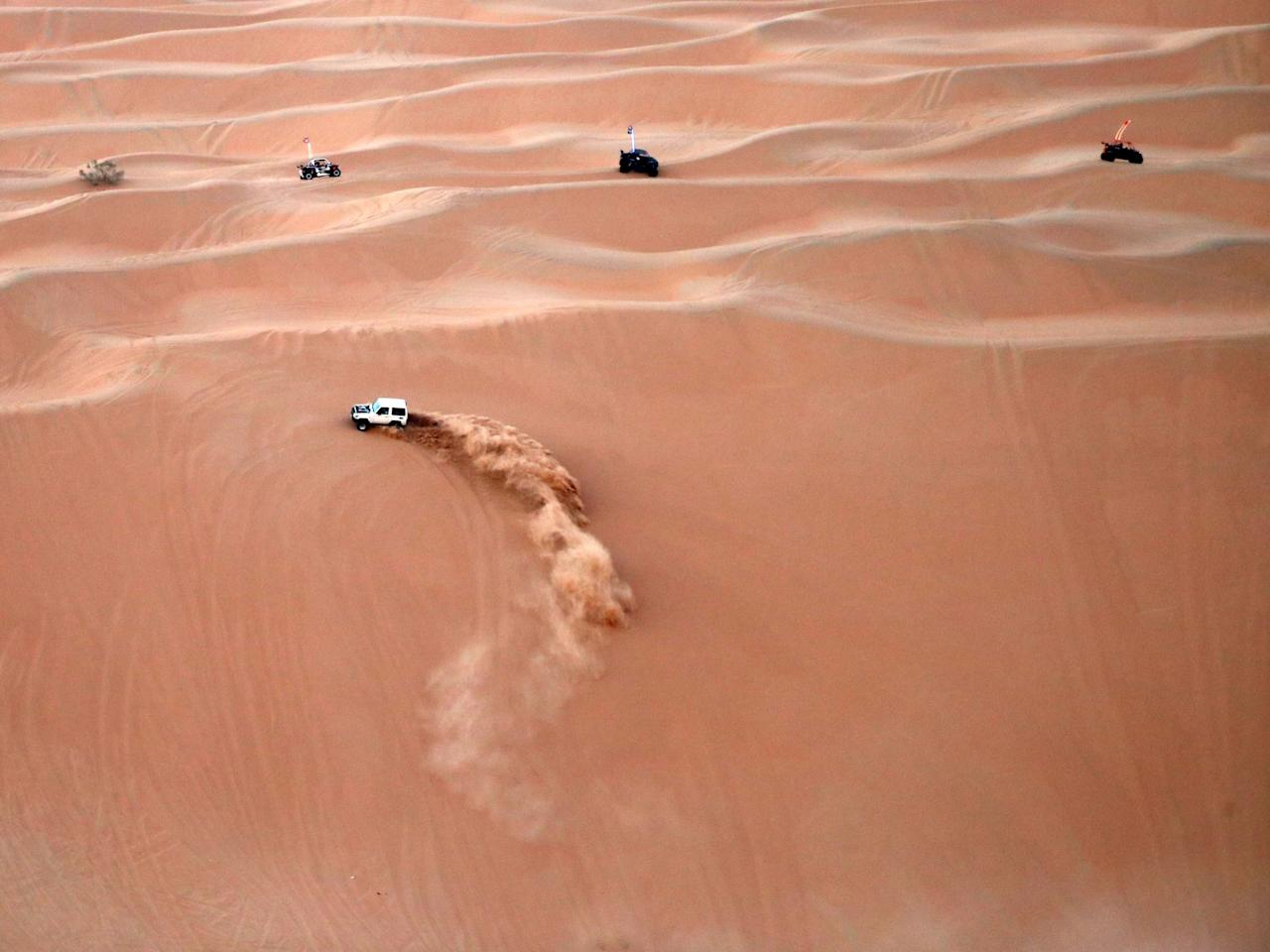 <p>A dune buggy practices before a race at the annual Moreeb Dune Festival on Jan. 1 in the Liwa desert. (Photo: Karim Sahib/AFP/Getty Images) </p>