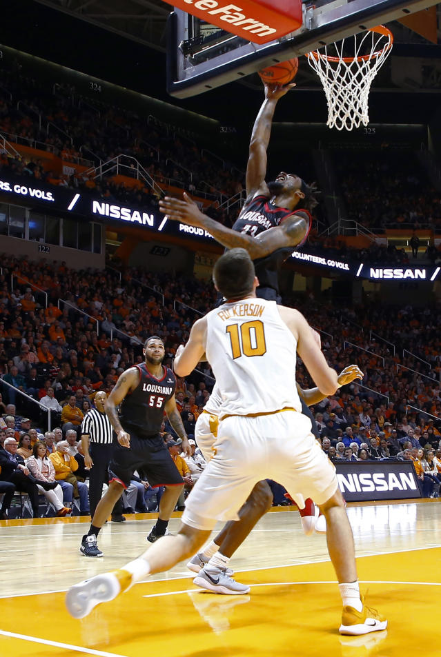 Louisiana-Lafayette forward JaKeenan Gant (23) shoots over Tennessee forward John Fulkerson (10) during the second half of an NCAA college basketball game Friday, Nov. 9, 2018, in Knoxville, Tenn. Tennessee won 87-65. (AP photo/Wade Payne)