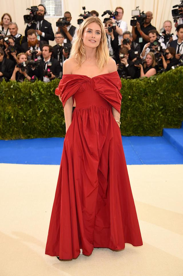 <p>The model wore a red off-the-shoulder gown from Brock Collection's fall 2017 collection. (Photo by Dimitrios Kambouris/Getty Images) </p>