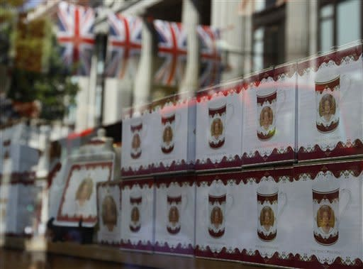 Reflections of the British Union flag are seen in a shop window displaying Diamond Jubilee souvenirs, in Oxford Street, London, Friday, May 25, 2012. The capital is preparing to celebrate the Diamond Jubilee, marking the Queen's 60 year reign. (AP Photo/Kirsty Wigglesworth)