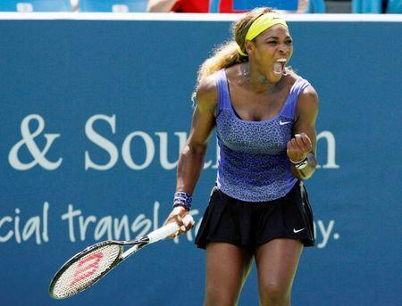 Aug 13, 2014; Cincinnati, OH, USA; Serena Williams reacts during the match against Samantha Stosur on day three of the Western and Southern Open tennis tournament at Linder Family Tennis Center. Mark Zerof-USA TODAY Sports