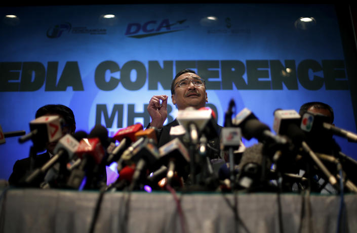 Malaysia's Minister of Transport Hishamuddin Hussein takes questions from the media during a press conference about the missing Malaysia Airlines jetliner MH370, Thursday, March 13, 2014, in Sepang, Malaysia. Planes sent Thursday to check the spot where Chinese satellite images showed possible debris from the missing Malaysian jetliner found nothing, Malaysia's civil aviation chief said, deflating the latest lead in the six-day hunt. The hunt for the missing Malaysia Airlines flight 370 has been punctuated by false leads since it disappeared with 239 people aboard about an hour after leaving Kuala Lumpur for Beijing early Saturday. (AP Photo/Wong Maye-E)