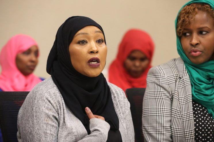 Asma Jama, the victim of a beer mug attack at the Coon Rapids Applebee's, and Farhio Khalif, Executive Director of the non-profit Voice of East African Women, right, addressed the effects of Islamaphobia on Oct. 20, 2016. (Photo: Richard Tsong-Taatarii/Minneapolis Star Tribune via ZUMA Wire)