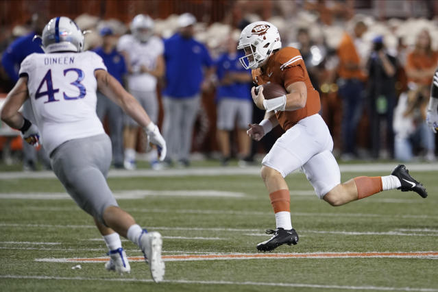 How much extra time did Texas get for its final drive? (AP Photo/Chuck Burton)