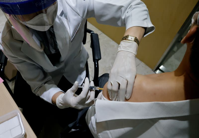 FILE PHOTO: A man gets an influenza vaccine at a branch of the Korea Association of Health Promotion in Seoul