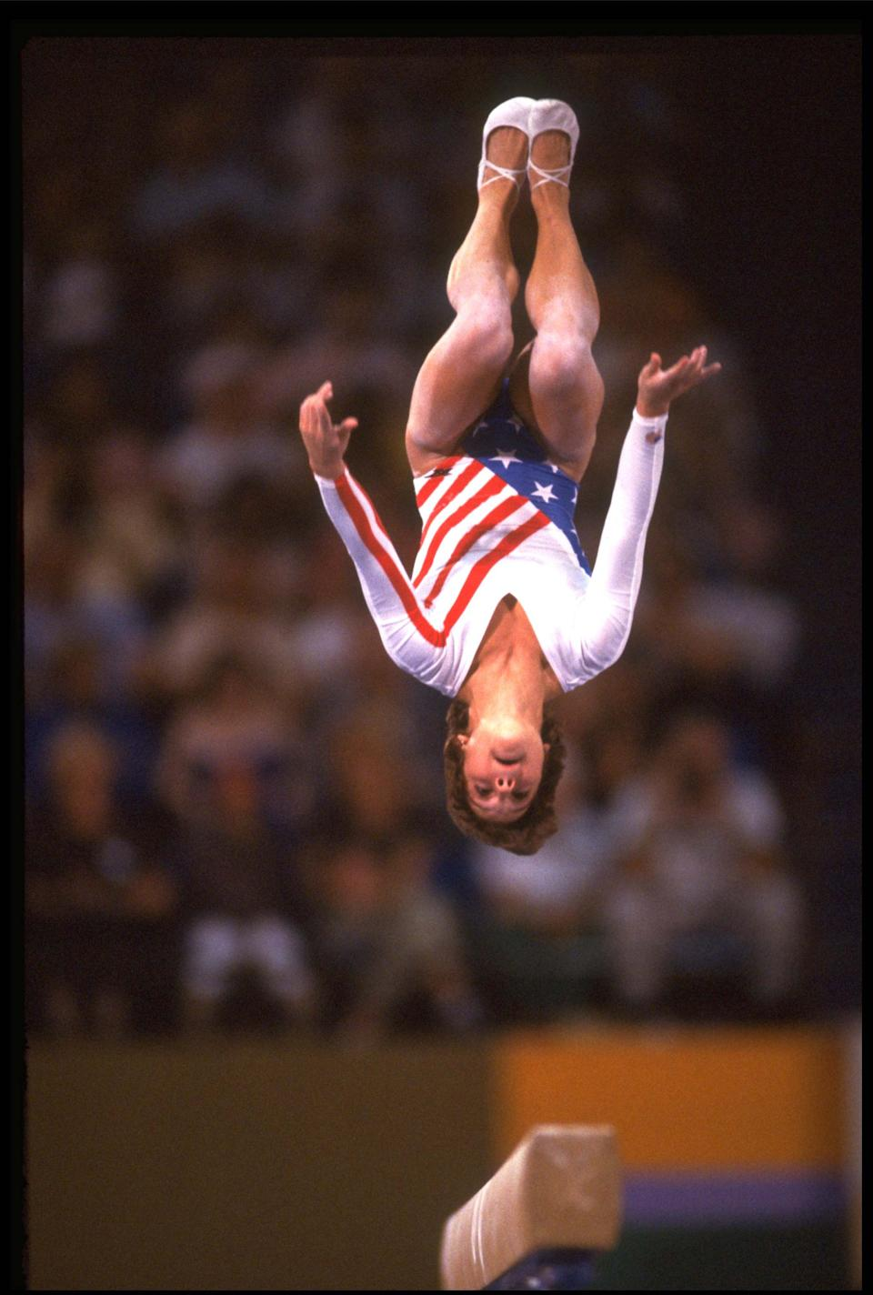 5 AUG 1988: MARY LOU RETTON OF THE UNITED STATES PERFORMS A FLIP ON THE BALANCE BEAM DURING HER ROUTINE AT THE 1984 LOS ANGELES OLYMPICS. RETTON WON THE OVERALL GYMNASTICS GOLD MEDAL.