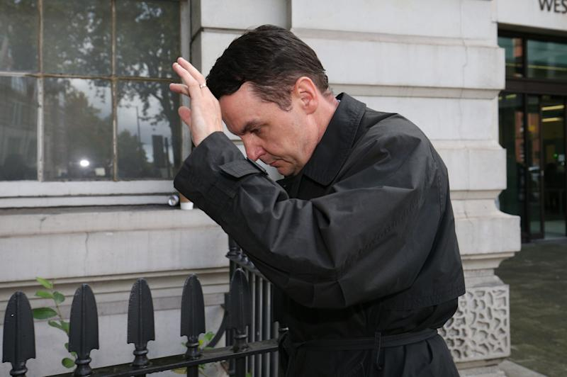 RETRANSMITTING CORRECTING SPELLING OF NAME Daren Timpson-Hunt leaves Westminster Magistrates' Court in London, where he was handed a 24-month community order in one of the first convictions under a new law against upskirting.