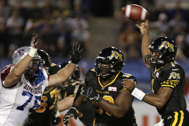Hamilton Tiger-Cats Henry Burris (R) throws a pass during the second half of the 2013 CFL Touchdown Atlantic game against the Montreal Alouettes in Moncton, New Brunchwick, September 21, 2013. REUTERS/Devaan Ingraham (CANADA - Tags: SPORT FOOTBALL)