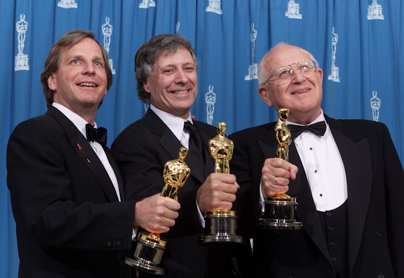 Douglas Wick, David Franzoni, and Branko Lustig, left to right, with Oscars for Best Picture of the Year for 'Gladiator,' at the 73rd Annual Academy Awards at the Shrine Auditorium in Los Angeles Sunday, March 25, 2001. Photo by Kevin Winter/Getty Images