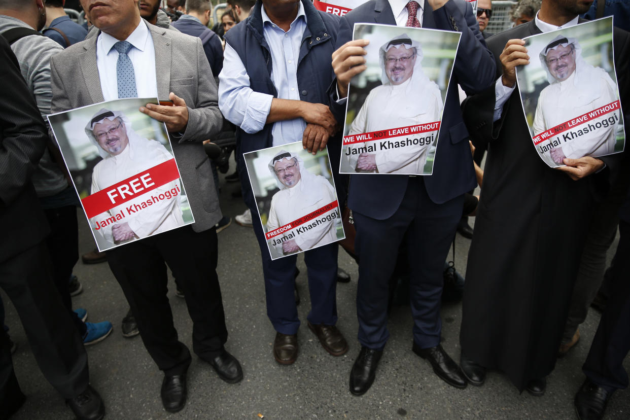 Members of the Turkish-Arab journalist association hold posters with photos of missing Saudi writer Jamal Khashoggi as they hold a protest near the Saudi Arabia Consulate in Istanbul on Monday. (Photo: Lefteris Pitarakis/AP)