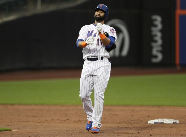 New York Mets' Jose Bautista (11) gestures to teammates after hitting a double during the second inning of a baseball game against the Miami Marlins Tuesday, May 22, 2018, in New York. (AP Photo/Frank Franklin II)