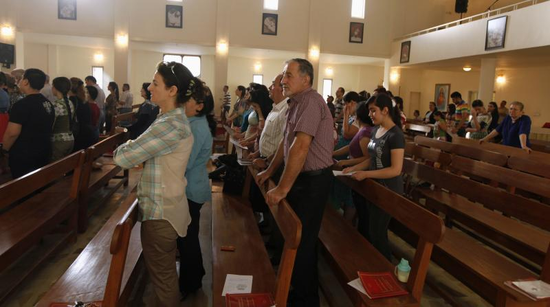 Iraqi Christians attend a mass at St. Joseph Chaldean Church in Baghdad
