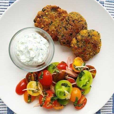 """<p>These chickpea fritters are tzatz-freaky good.</p><p>Get the <a href=""""https://www.delish.com/uk/cooking/recipes/a28840153/crispy-chickpea-fritters-tzatziki-tomato-salad-recipe/"""" rel=""""nofollow noopener"""" target=""""_blank"""" data-ylk=""""slk:Crispy Chickpea Fritters with Tzatziki and Tomato Salad"""" class=""""link rapid-noclick-resp"""">Crispy Chickpea Fritters with Tzatziki and Tomato Salad</a> recipe.</p>"""