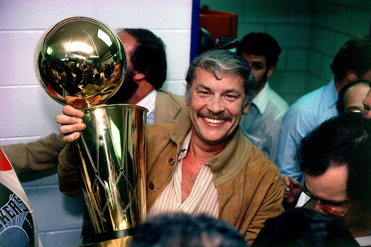 <p>qUSA - 1980: Los Angeles Lakers owner Jerry Buss poses with the NBA Championship trophy in 1980. NOTE TO USER: User expressly acknowledges that, by downloading and or using this photograph, User is consenting to the terms and conditions of the Getty Images License agreement. Mandatory Copyright Notice: Copyright 1980 NBAE (Photo by Rich Pilling/NBAE via Getty Images)</p>