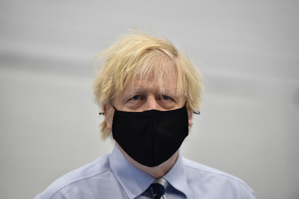Britain's Prime Minister Boris Johnson tours the Lakeland Forum Covid-19 vaccination centre on March 12, 2021 in Enniskillen, Northern Ireland. (Photo by Charles McQuillan / POOL / AFP) (Photo by CHARLES MCQUILLAN/POOL/AFP via Getty Images)