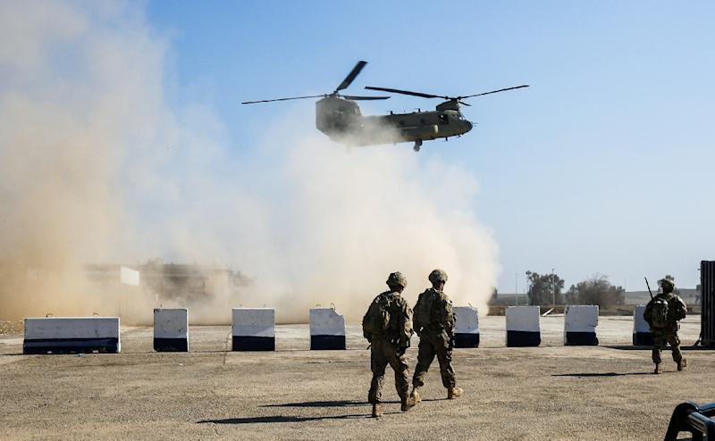 US Army C-47 Chinook helicopter flies over the village of Oreij, south of Mosul where a temporary military base has been established for an assault on the city's west bank (AFP Photo/AHMAD AL-RUBAYE)
