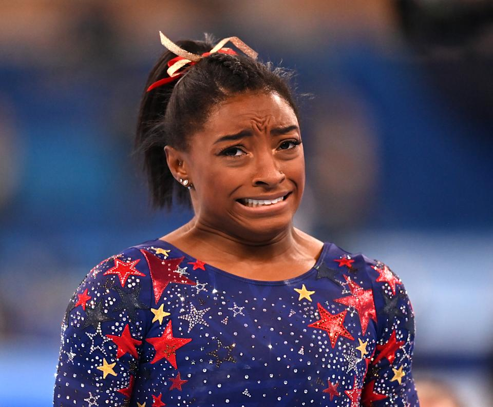 TOKYO, JAPAN - JULY 25: Simone Biles of the US reacts during the artistic gymnastic women's qualification at the Tokyo 2020 Olympic Games at Ariake Gymnastics Centre in Tokyo, Japan on July 25, 2021. (Photo by Mustafa Yalcin/Anadolu Agency via Getty Images)