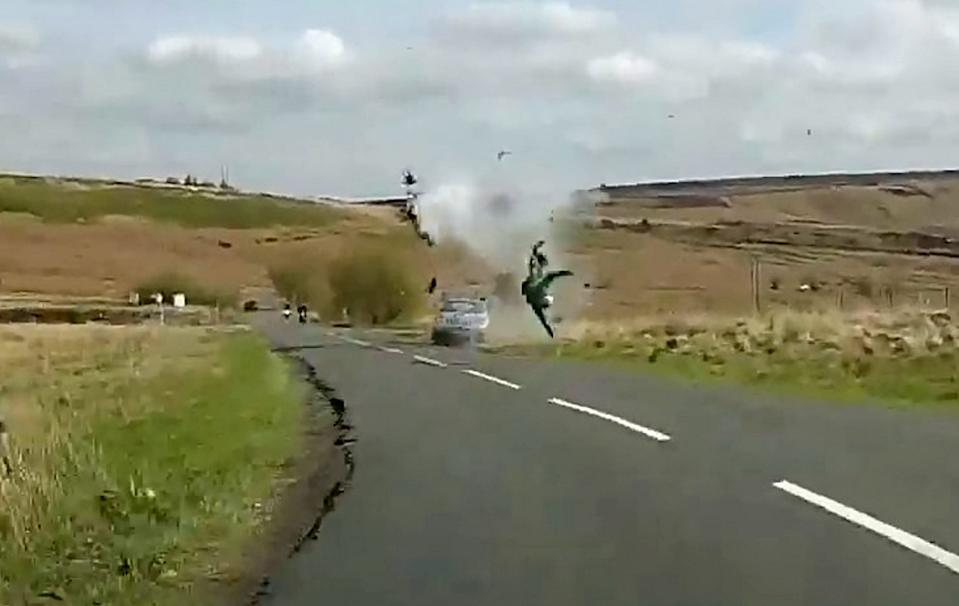 Dramatic footage of a 70mph head-on crash which left a motorcyclist with life changing injuries.  See SWNS story SWLEcrash.  On 28 April last year, the 35-year-old was riding along Mortimer Road, Sheffield when he was hit by a driver travelling 70mph on the wrong side of the road.  The horrifying footage first shows the car travelling around a blind left-hand bend. Due to the driver's excessive speed, it veers on to the wrong side of the road. As the Subaru driver fails to regain control, the video shows the motorcyclist brake, before the two collide head-on. The motorcyclist is then catapulted through the air.  The experienced ride suffered a broken back, a broken sternum and a broken wrist in the crash. His Suzuki K7 sports bike was completely destroyed on impact.  The victim, from Barnsley, has since credited the protective gear he was wearing at the time with saving his life.