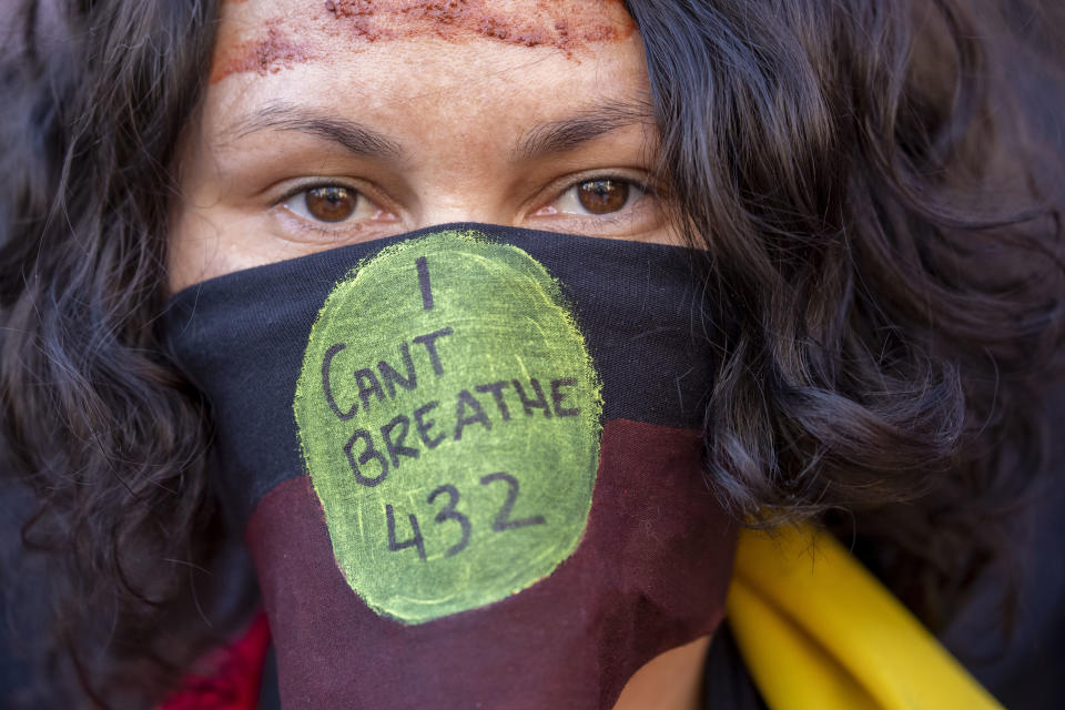Protesters displayed the number 432, the number of aboriginal deaths in police custody since a 1991 Royal Commission into the matter. Source: AAP