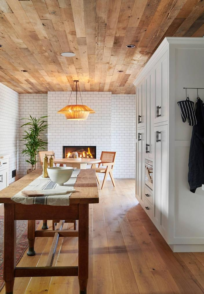Lovely Los Feliz kitchen and dining renovation from Ashley Tisdale's Frenshe Interiors, complete with a fireplace by Michael Tisdale.