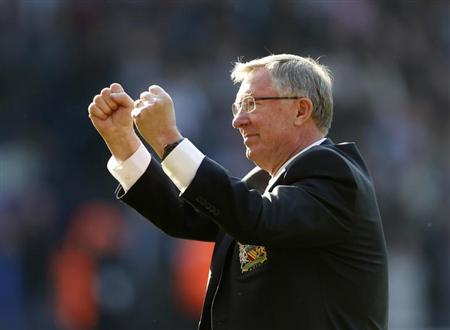Manchester United manager Alex Ferguson salutes the fans after their English Premier League soccer match against West Bromwich Albion at The Hawthorns in West Bromwich, central England, May 19, 2013.