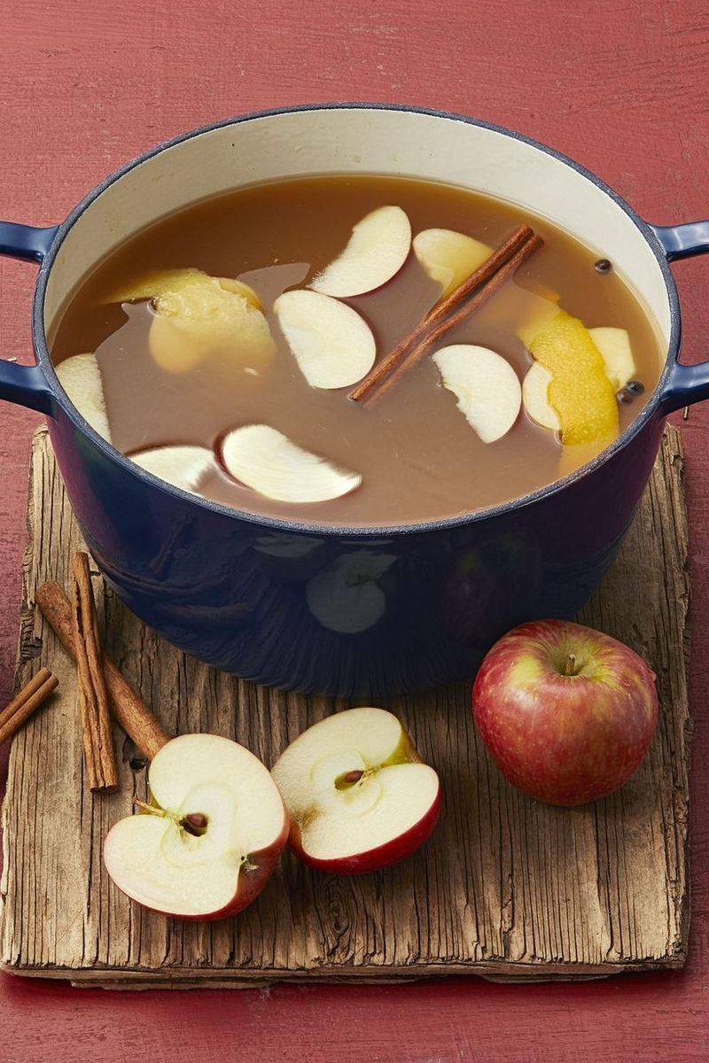 """<p>Channel your inner witch as you stir this easy and festive mulled maple apple cider brew. This cozy blend features hints of citrus and cinnamon.</p><p><a href=""""https://www.thepioneerwoman.com/food-cooking/recipes/a34276628/mulled-maple-apple-cider/"""" rel=""""nofollow noopener"""" target=""""_blank"""" data-ylk=""""slk:Get the recipe."""" class=""""link rapid-noclick-resp""""><strong>Get the recipe.</strong></a></p><p><a class=""""link rapid-noclick-resp"""" href=""""https://go.redirectingat.com/?id=74968X1616970&xs=1&url=https%3A%2F%2Fwww.walmart.com%2Fip%2FThe-Pioneer-Woman-Timeless-Beauty-Cast-Iron-5-Quart-Dutch-Oven-Turquoise%2F269067081&sref=https%3A%2F%2Fwww.thepioneerwoman.com%2Fholidays-celebrations%2Fg36792938%2Fhalloween-punch-recipes%2F&xcust=%5Butm_source%7C%5Butm_campaign%7C%5Butm_medium%7C%5Bgclid%7C%5Bmsclkid%7C%5Bfbclid%7C%5Brefdomain%7C%5Bcontent_id%7C063ca788-5949-46f9-a636-dd388bf33e83%5Bcontent_product_id%7C%5Bproduct_retailer_id%7C"""" rel=""""nofollow noopener"""" target=""""_blank"""" data-ylk=""""slk:SHOP DUTCH OVENS"""">SHOP DUTCH OVENS</a></p>"""
