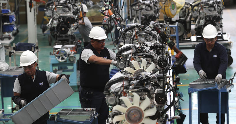 Workers assemble cars at the General Motors plant in Quito, Ecuador, Tuesday, Oct. 15, 2019. The recent national strike has left President Lenin Moreno and his administration struggling to figure out how stabilize the budget, reassure international lenders and put Ecuador put on a path of economic sustainability. (AP Photo/Dolores Ochoa)