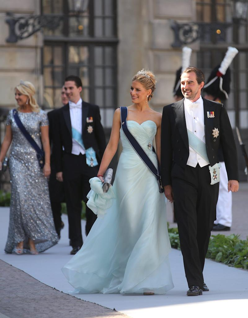 Prince Nikolaos of Greece and his wife Tatiana arrive at the Royal Chapel for the wedding of Sweden's Princess Madeleine and Christopher O'Neill, in Stockholm, Saturday June 8, 2013. (AP Photo/Soren Andersson) SWEDEN OUT