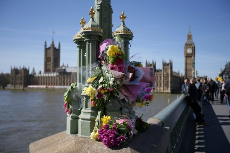 Floral tributes to the victims of the March 22 terror attack are seen on Westminster Bridge near the Houses of Parliament in central London