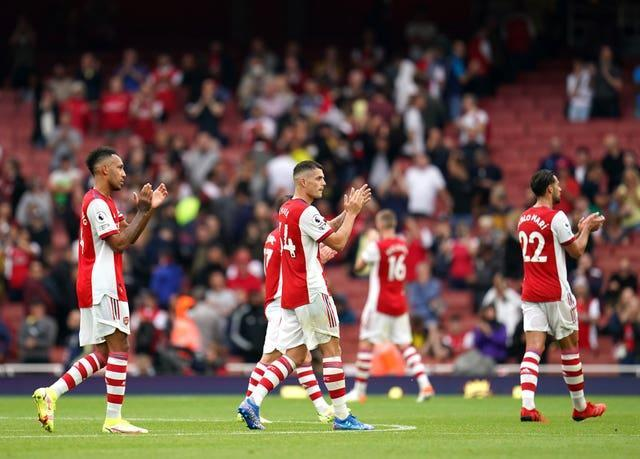 Granit Xhaka (centre) could not help Arsenal avoid defeat to Chelsea.