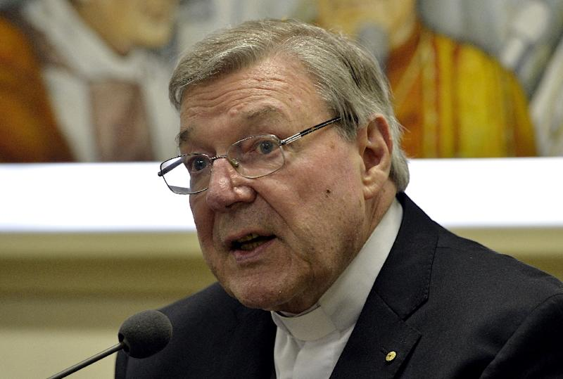 Australian Cardinal George Pell, a top aide to Pope Francis, has been charged with several sex offences in Australia (AFP Photo/Andreas SOLARO)
