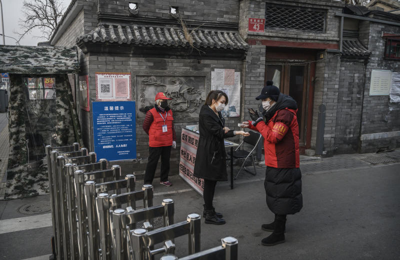 BEIJING, CHINA - FEBRUARY 19: Members of a local neighbourhood committee wear protective masks as they check the temperature of a resident entering at a barricade placed to control people entering and exiting a local hutong as part of government efforts to control the spread of the coronavirus on February 19, 2020 in Beijing, China. The number of cases of the deadly new coronavirus COVID-19 rose to more than 58000 in mainland China Wednesday, in what the World Health Organization (WHO) has declared a global public health emergency. China continued to lock down the city of Wuhan in an effort to contain the spread of the pneumonia-like disease which medicals experts have confirmed can be passed from human to human. In an unprecedented move, Chinese authorities have maintained and in some cases tightened the travel restrictions on the city which is the epicentre of the virus and also in municipalities in other parts of the country affecting tens of millions of people. The number of those who have died from the virus in China climbed to over 2000 on Wednesday mostly in Hubei province, and cases have been reported in other countries including the United States, Canada, Australia, Japan, South Korea, India, the United Kingdom, Germany, France and several others. The World Health Organization has warned all governments to be on alert and screening has been stepped up at airports around the world. Some countries, including the United States, have put restrictions on Chinese travellers entering and advised their citizens against travel to China. (Photo by Kevin Frayer/Getty Images)