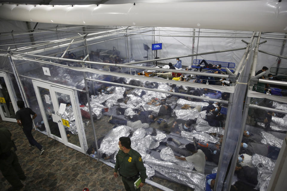 FILE - In this March 30, 2021, file photo, young minors lie inside a pod at the Donna Department of Homeland Security holding facility, the main detention center for unaccompanied children in the Rio Grande Valley run by U.S. Customs and Border Protection (CBP), in Donna, Texas. Migrant families will be held at hotels in the Phoenix area in response to a growing number of people crossing the U.S.-Mexico border, authorities said Friday, April 9, 2021 another step in the Biden administration's rush to set up temporary space for them. (AP Photo/Dario Lopez-Mills, Pool, File)