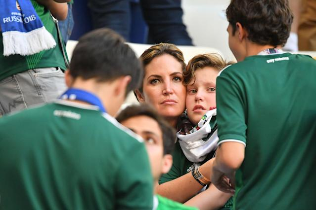 <p>Mexico fans react at the end of the Russia 2018 World Cup round of 16 football match between Brazil and Mexico at the Samara Arena in Samara on July 2, 2018. (Photo by EMMANUEL DUNAND / AFP) </p>