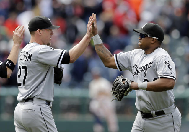 Chicago White Sox relief pitcher Matt Lindstrom (27) celebrates with right fielder Dayan Viciedo after a 4-3 win over the Cleveland Indians in a baseball game Sunday, May 4, 2014, in Cleveland. Viciedo's three-run home run in the ninth inning gave the White Sox their first lead and Lindstrom retired the Indians in the bottom of the inning for the save. (AP Photo/Mark Duncan)