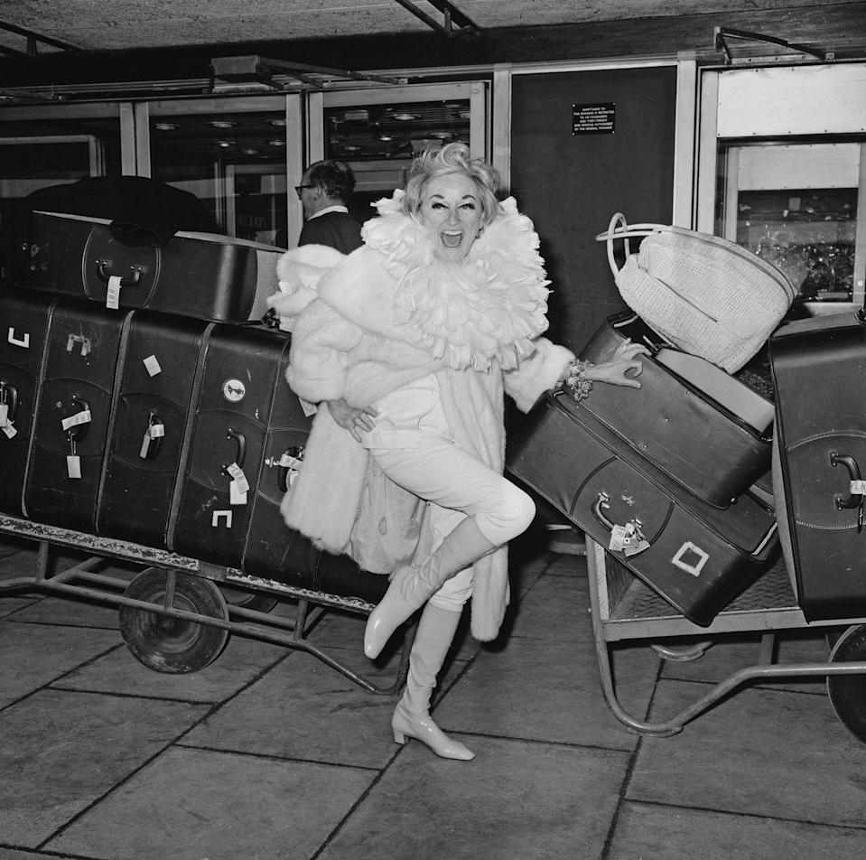 <p><strong>Phyllis Diller, 1968</strong><strong>:</strong> When this photo was taken, American comedian Phyllis Diller had just arrived at London's Heathrow airport with 35 (!) suitcases. Which is perhaps why she's wearing an absurd amount of fabric around her neck...so she doesn't have to check a 36th bag? </p>