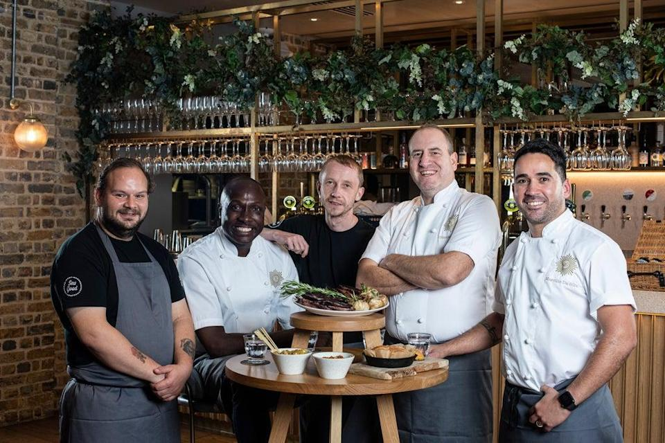 Service with a purpose: head chef Marcilio da Silva, far right, leads the Brigade restaurant founded by Simon Boyle, second from right. Pictured with their apprentices, the pair help at-risk people to transform their lives (Daniel Hambury/Stella Pictures Ltd)