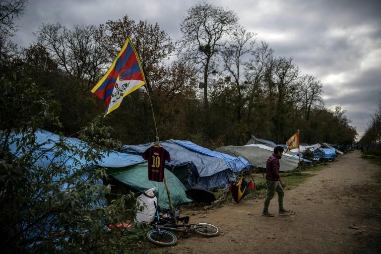 The makeshift camp set up by Tibetan asylum seekers near a  forest in Acheres, northwest of Paris