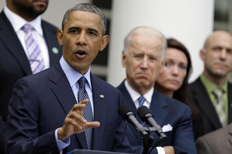 President Barack Obama, next to Vice President Joe Biden, gestures as he speaks during a news conference in the Rose Garden of the White House, in Washington, on Wednesday, April 17, 2013, about the defeat in the Senate of a bill to expand background checks on guns. (AP Photo/Manuel Balce Ceneta)