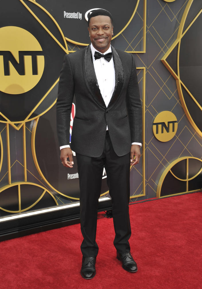 FILE - Chris Tucker arrives at the NBA Awards on June 24, 2019, in Santa Monica, Calif. Tucker turns 49 on Aug. 31. (Photo by Richard Shotwell/Invision/AP, File)