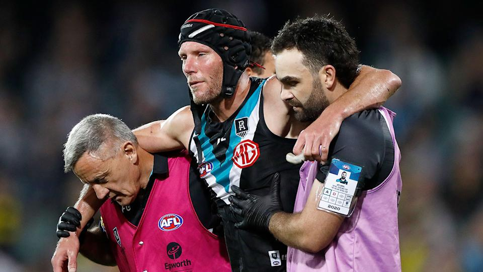 Seen here, Brad Ebert is helped off the field for Port Adelaide against Richmond in the 2020 AFL finals.