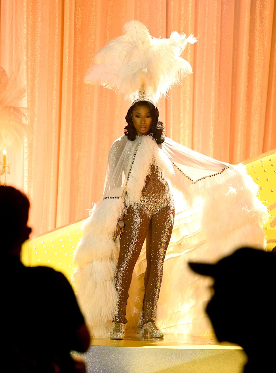 <h2>Megan Thee Stallion</h2><br>Megan Thee Stallion was a 1920s angel in this feathered getup at the Grammys.