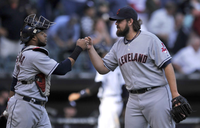 Cleveland Indians closing pitcher Chris Perez right, celebrates with catcher Carlos Santana after defeating the Chicago White Sox 3-1 in a baseball game in Chicago, Friday, Sept. 13, 2013. (AP Photo/Paul Beaty)
