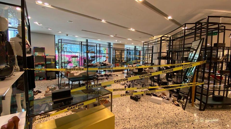 Opened boxes of shoes thrown all around the floor in an area cordoned off by 'caution' tapes at The Heeren outlet. Photo: Coconuts