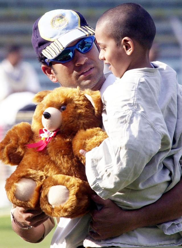 BOMBAY, INDIA: India's star batsman Sachin Tendulkar (L) holds six-year old cancer patient Ganesh Shankar 02 Febuary 2002 at Wankhade Stadium in Bombay. Shankar will undergo major surgery to remove a tumor from behind his right eye. India will play England in the last of six one-day internationals 03 February. AFP PHOTO / Sebastian D'SOUZA (Photo credit should read SEBASTIAN D'SOUZA/AFP/Getty Images)