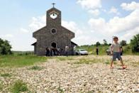 Catholic villagers gather in front of the church in the village of Kravaseri. Only about 50,000 of Kosovo's 1.7 million citizens are Catholics, while more than 90 percent of the population are Muslim