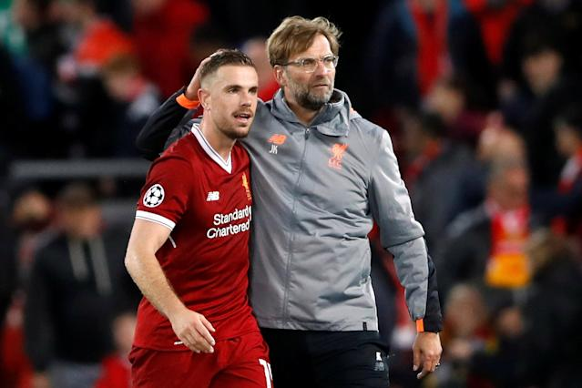 Soccer Football - Champions League Semi Final First Leg - Liverpool vs AS Roma - Anfield, Liverpool, Britain - April 24, 2018 Liverpool manager Juergen Klopp celebrates with Jordan Henderson after the match Action Images via Reuters/Carl Recine