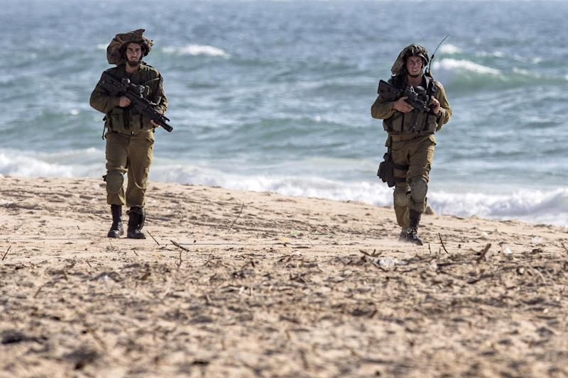 A picture taken from the southern Israeli border with the Gaza Strip on July 9, 2014, shows Israeli soldiers patrolling the shore on the Mediterranean Sea (AFP Photo/Jack Guez)