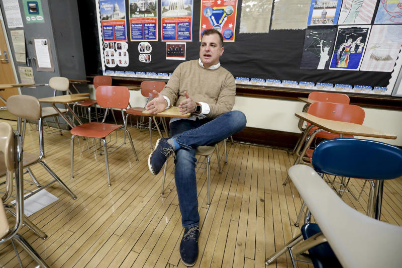 "William Marx sits in the classroom where he teaches civics in Pittsburgh on Friday, Nov. 16, 2018. Marx was a plaintiff in the Pennsylvania lawsuit that successfully challenged the Republican-drawn congressional maps. Marx said he believes the new district boundaries resulted in ""a more fair congressional representation of the will of the people in Pennsylvania."" (AP Photo/Keith Srakocic)"