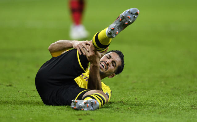 Dortmund's Emre Can reacts on the ground during the German Bundesliga soccer match between Bayer Leverkusen and Borussia Dortmund in Leverkusen, Germany, Saturday, Feb. 8, 2020. Leverkusen defeated Dortmund with 4-3. (AP Photo/Martin Meissner)